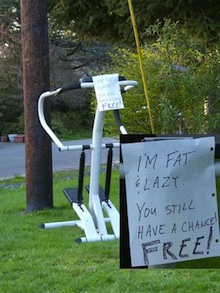 Photo of a treadmill with a funny sign about getting fat on it