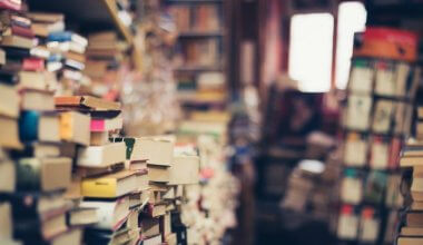 lots of books piled up in a bookshop