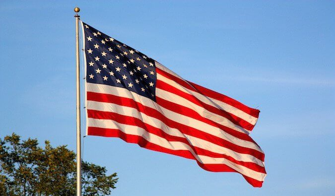 A giant American flag waving in the wind