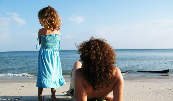 Leigh Shulman relaxing on the beach with her daughter