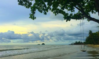 a beach with a swing over the sea in koh chang