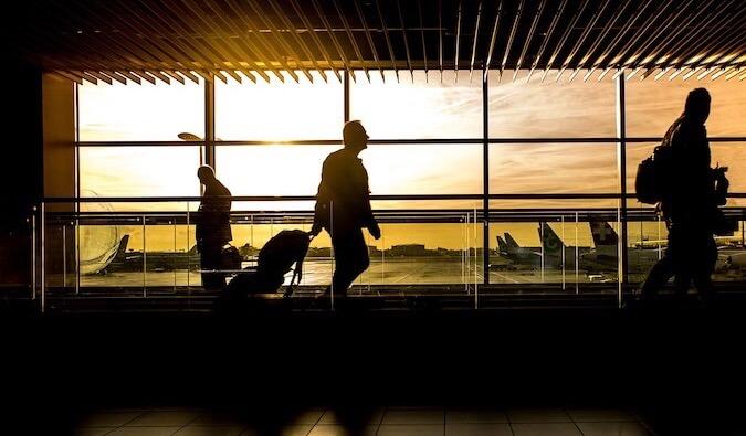 An airport terminal at sunset