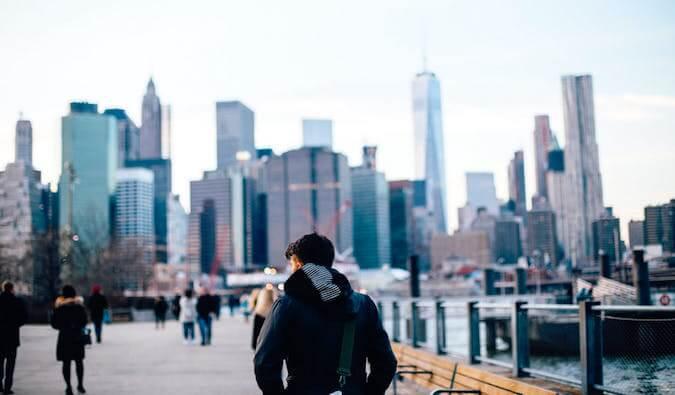 A guy walking alone in NYC