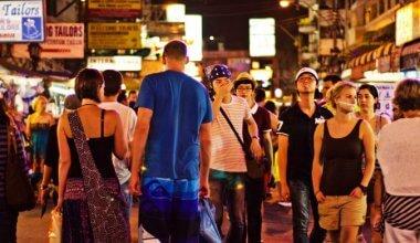 tourists walking on Ko San Road in Bangkok Thailand