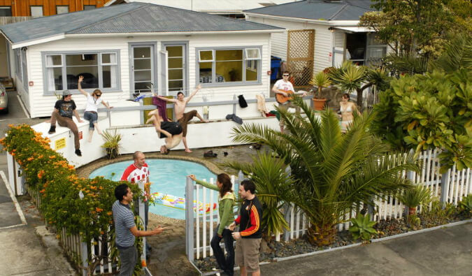 pool party with man drinking and jumping in to the pool