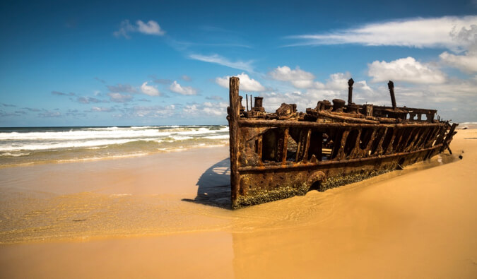 Shipwreck on the beach blue sky and sea in the background