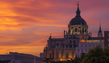 historic building in Madrid at sunset with orange sky