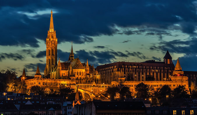 view of a church lit up at night in the city of Budapest