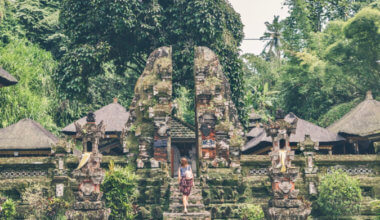 a solo female traveler visiting a temple in Southeast Asia