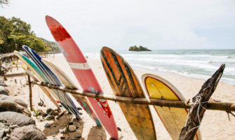 colorful surfboards resting on the beach in Costa Rica