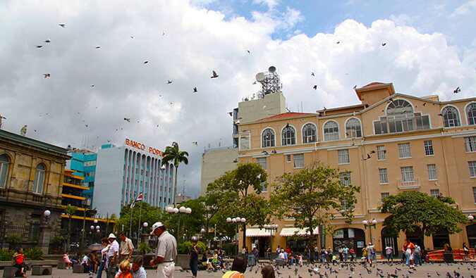 San Jose Square in Costa Rica. People, birds, and shops.