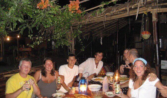 Nomadic Matt with backpackers on the island of Ko Lipe