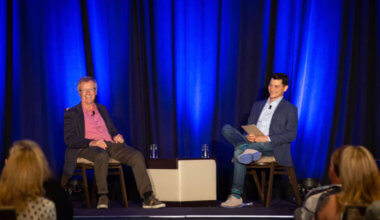 Nomadic Matt interviewing Tony Wheeler at TravelCon 2019 in Boston