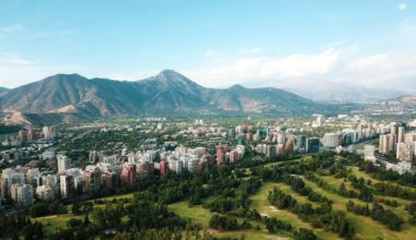 A sweeping view of Santiago, Chile with green mountains in the background