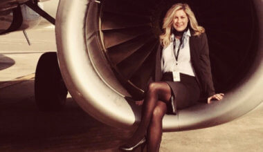 Flight attendant Heather Poole posing by an airplane