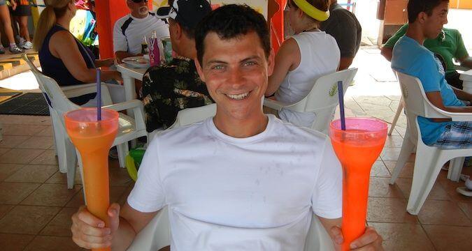 nomadic matt on his cruise drinking frozen drinks