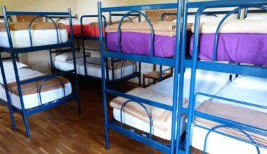 Bunk beds in an empty dorm in a hostel