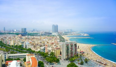 areal shot of Barcelona city is to the left and the beach and sea to the right