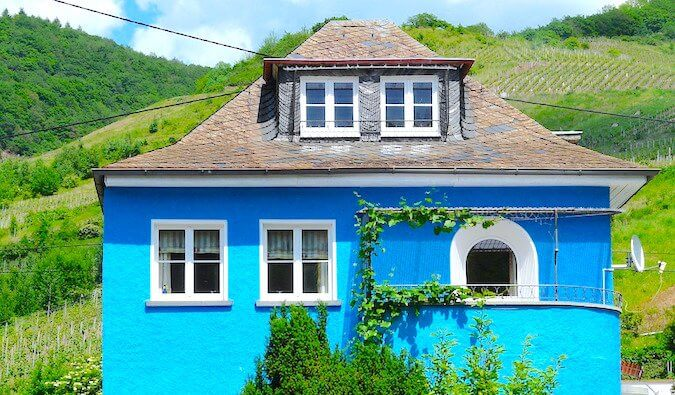 A blue house in the hills