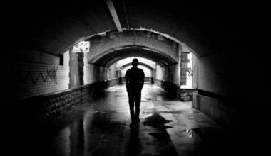 a solo traveler in a dark tunnel