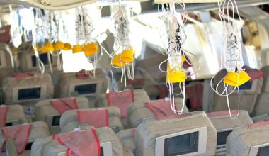 oxygen masks on a plane hanging down over the seats