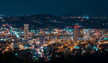 City view of Portland Oregon lit up at night taken from a high vantage point