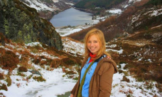 A solo female traveler in the snow overseas