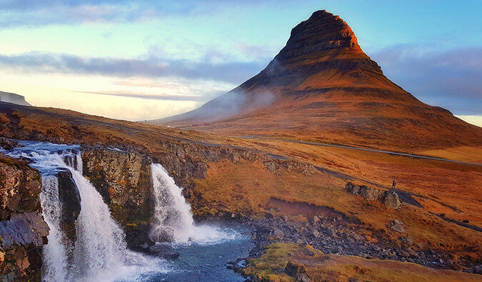 image of a waterfall in Iceland with a rock formation in the background
