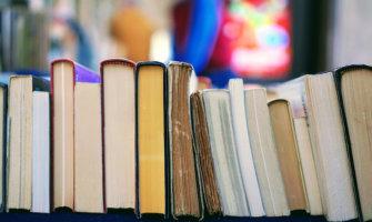 books lined up on a bookshelf