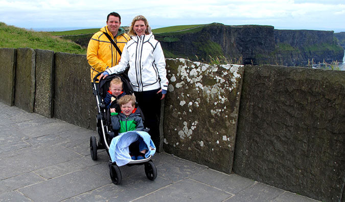 a family photo in Ireland. Mum, Dad and two small children in a buggy