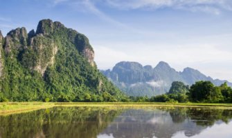 A karst mountain near the water in Vang Vieng, Laos