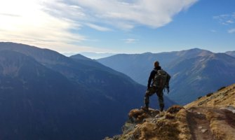 A solo traveler hiking in the mountains