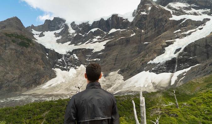 Nomadic Matt looking at mountains in Patagonia