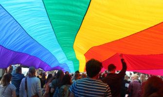 A huge rainbow flag at a gay pride parade