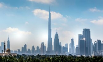 The towering skyline of downtown Dubai, including he massive Burj Khalifa