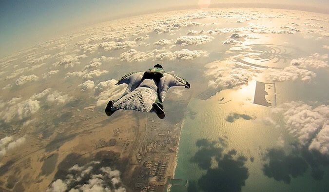 A guy jumping out of a plane