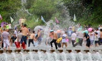 People having a water fight in Thailand during Songkran