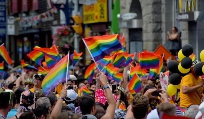 People waving the lgbtq flag