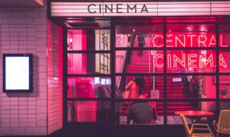 The neon lights of an old cinema at night