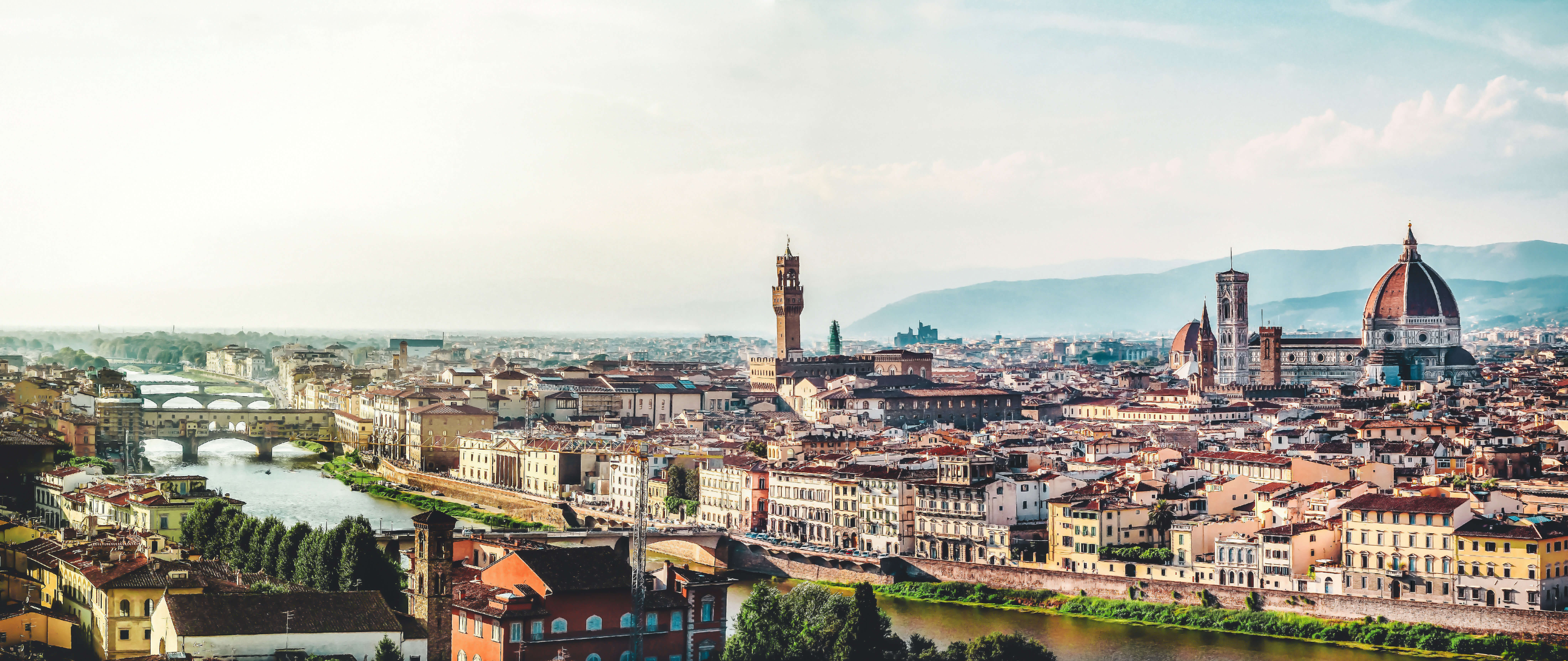 view of an Italian city with a river running through