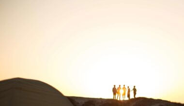 People standing on a mountain at sunrise
