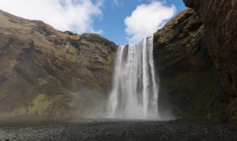 Skogafoss waterfall in Iceland on a bright summer day