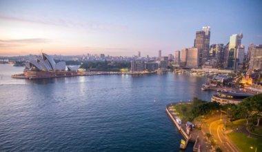 The Sydney, Australia skyline and Opera House lit up at night
