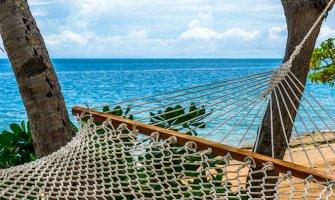 hammock on the beach sand and blue sea