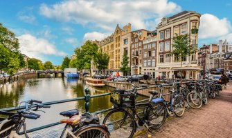 bicycles lining a bridge over the canal in Amsterdam
