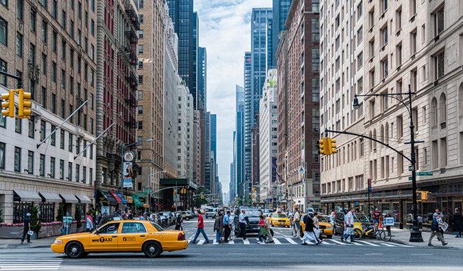 The best places to stay in New York City New York City street scene yellow taxi people and crossing the street