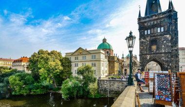 man standing on bridge in Prague