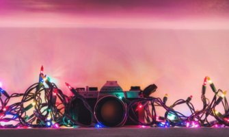 a camera covered in Christmas lights