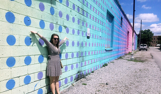 Caroline Eubanks standing in front of murals in Chattanooga, Tennessee