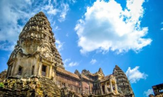 A blue sky over the ancient buildings of Angkor Wat in Cambodia